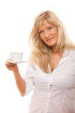 Mature woman drinking tea or coffee.. Royalty Free Stock Photography
