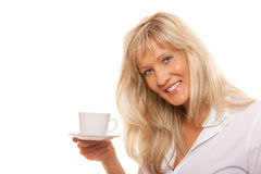 Mature woman drinking tea or coffee.. Stock Images