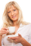 Mature woman drinking tea or coffee.. People, happiness, drink and food concept. Mature woman drinking tea or coffee. Cup of Hot Beverage. white background Stock Photography