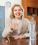 Mature woman drinking water from glass Royalty Free Stock Images