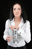 Mature woman drinks water Royalty Free Stock Image