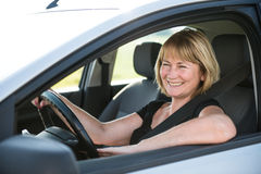 Mature woman driving car Royalty Free Stock Photos