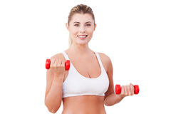 Mature woman with dumbbells. Royalty Free Stock Photos