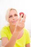 Mature woman eating strawberry Royalty Free Stock Photos