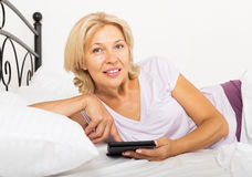 Mature woman with eBook or tablet Stock Images