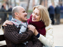 Mature woman and elderly man posing together outdoors Stock Images