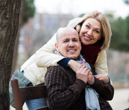 Mature woman and elderly man posing together Stock Photography