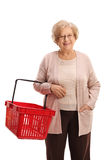 Mature woman with an empty shopping basket Royalty Free Stock Photography
