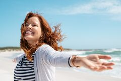 Free Mature Woman Enjoy Breeze At Beach Royalty Free Stock Photography - 181061387