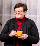 Mature woman enjoying cup of coffee Royalty Free Stock Photo