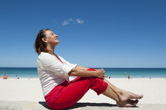 Mature Woman enjoying life at the beach Royalty Free Stock Photography