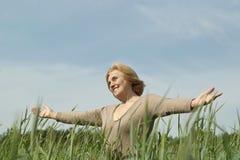 Mature woman enjoying on nature Royalty Free Stock Photos