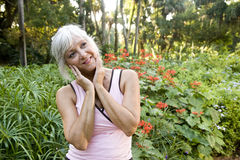 Mature woman enjoying park foliage Stock Image
