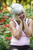 Mature woman enjoying park foliage Stock Photo