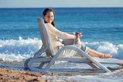 Mature woman enjoying  on sea beach Stock Images