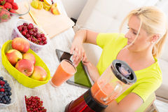 Mature woman enjoying a smoothie Stock Images
