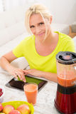 Mature woman enjoying a smoothie Royalty Free Stock Photo
