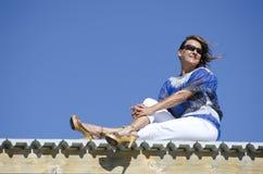 Mature Woman enjoying the sunshine on a boardwalk Stock Image