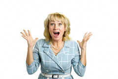 Mature woman excited on white. Royalty Free Stock Images
