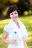 Mature woman after exercise Stock Images