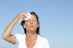 Mature woman exercise stress sweating Stock Image