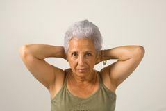 Mature woman exercising. At home Stock Image