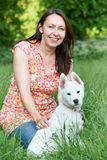 Mature Woman Exercising Dog In Countryside Stock Images
