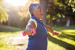 Mature woman exercising with dumbbell Royalty Free Stock Photo