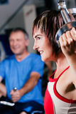 Mature woman exercising in gym Stock Images
