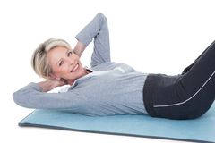 Mature woman exercising Stock Photography