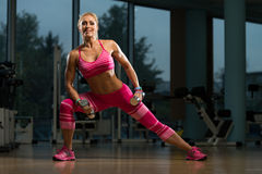 Mature Woman Exercising Shoulders With Dumbbells Stock Photography