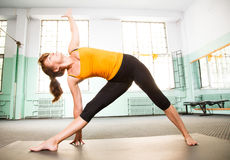 Mature woman exercising yoga Royalty Free Stock Photos