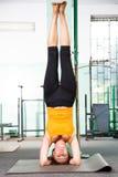Mature woman exercising yoga Stock Image