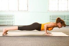 Mature woman exercising yoga Stock Photos
