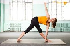 Mature woman exercising yoga Royalty Free Stock Photography