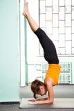Mature woman exercising yoga Royalty Free Stock Photos