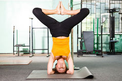 Mature woman exercising yoga Royalty Free Stock Images