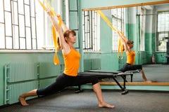 Mature woman exercising yoga Stock Photography