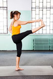 Mature woman exercising yoga Royalty Free Stock Photo