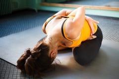 Mature woman exercising yoga Stock Photo