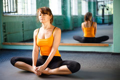 Mature woman exercising yoga Stock Photography