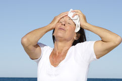 Mature woman exhausted stress sweating royalty free stock images