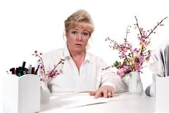Mature woman explaining paperwork Royalty Free Stock Photos