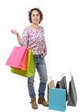 Mature woman with eyeglasses went shopping on white background. A mature woman with eyeglasses went shopping on white background Stock Photography