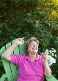 Mature Woman Feeling The Beat royalty free stock photos