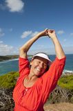 Mature Woman feeling Happy at Seaside Royalty Free Stock Photos