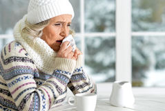 Mature woman feeling herself bad. Sitting in cafe Stock Photography
