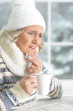 Mature woman feeling herself bad. Sitting in cafe Stock Photo
