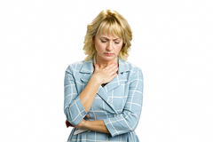 Mature woman feeling sore throat. Royalty Free Stock Photo