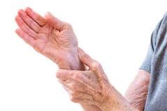 Mature woman feeling wrist pain, injury problem, healthcare concept, sprain. Acute pain in a senior woman wrist stock image